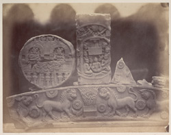 Sculpture pieces excavated from the Stupa at Bharhut: torana beam, disc carved with tala palm and firgures, sculpture slab with Idasalaguha scene